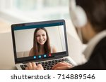 smiling girl on videocall with... | Shutterstock . vector #714889546