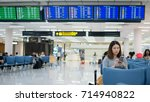 woman waiting for flight at the ... | Shutterstock . vector #714940822