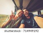 backpackers traveling around... | Shutterstock . vector #714949192