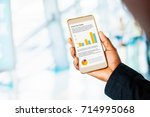 financial graphs on the screen. ... | Shutterstock . vector #714995068