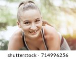 fit and sporty girl doing... | Shutterstock . vector #714996256