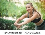 fit and sporty girl doing... | Shutterstock . vector #714996286