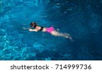 woman swimming in a pool . | Shutterstock . vector #714999736