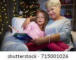 grandmother and grandaughter in ... | Shutterstock . vector #715001026