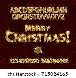 merry christmas with golden... | Shutterstock .eps vector #715024165
