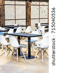 table with armchairs in the bar.... | Shutterstock . vector #715040536