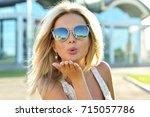 outdoor fashion portrait of... | Shutterstock . vector #715057786