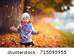 adorable happy girl playing... | Shutterstock . vector #715095955