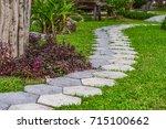 garden path and lawn. | Shutterstock . vector #715100662