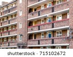 facade of a council tower block ... | Shutterstock . vector #715102672