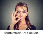keep a secret  woman zipping... | Shutterstock . vector #715103905