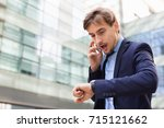 positive businessman talking... | Shutterstock . vector #715121662