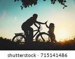 mother and little daughter... | Shutterstock . vector #715141486