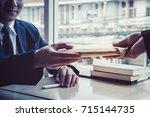 business man refusing money to... | Shutterstock . vector #715144735