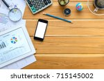 office desk table with tablet... | Shutterstock . vector #715145002