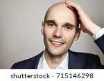 close up portrait of a handsome ... | Shutterstock . vector #715146298