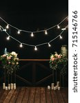white candles stand beneath a... | Shutterstock . vector #715146766