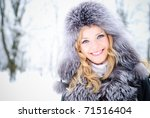 Blond woman outdoors in winter day - stock photo