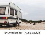 caravan camping trailer on the... | Shutterstock . vector #715168225
