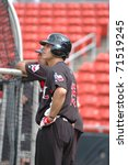 Small photo of HICKORY, NC USA - JULY 11 : David Paisano (15) of the Hickory Crawdads, class A affiliate of the Texas Rangers,prepares for batting practice in Hickory NC at LP Frans Stadium, July 11, 2009
