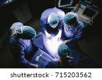 top view shot of team of... | Shutterstock . vector #715203562