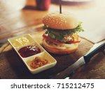 pork burger presented nicely on ... | Shutterstock . vector #715212475
