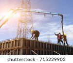workers are pouring concrete... | Shutterstock . vector #715229902