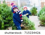 two little sibling kid boys... | Shutterstock . vector #715234426