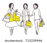 ladies go down the street with... | Shutterstock .eps vector #715239946