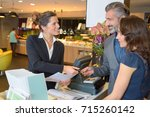 couple paying in restaurant | Shutterstock . vector #715260142