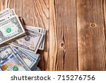 money isolated on a wooden... | Shutterstock . vector #715276756