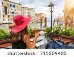 elegant woman with a red hat... | Shutterstock . vector #715309402