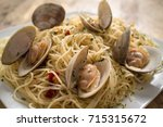 spaghetti with fresh cooked... | Shutterstock . vector #715315672