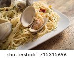 spaghetti with fresh cooked... | Shutterstock . vector #715315696