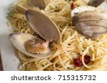 spaghetti with fresh cooked... | Shutterstock . vector #715315732