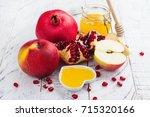 apple  honey and pomegranate on ... | Shutterstock . vector #715320166