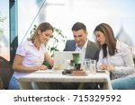 three young entrepreneurs are... | Shutterstock . vector #715329592