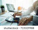 Businessman Using A Calculator...