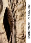 Small photo of ajar pocket of a man's jacket of natural color