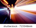 car on the road with motion... | Shutterstock . vector #715348666