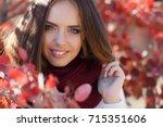 woman autumn portrait. cute...   Shutterstock . vector #715351606