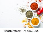 Various Spices In A Bowls On...