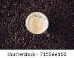 cup of coffee and coffee beans  ... | Shutterstock . vector #715366102