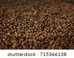 close up coffee beans background | Shutterstock . vector #715366138