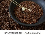 roasted coffee beans with... | Shutterstock . vector #715366192