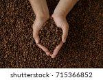 man's hands holding coffee beans | Shutterstock . vector #715366852