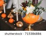 autumn floral bouquet in a...   Shutterstock . vector #715386886