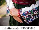embroidered shirt. hands of a...   Shutterstock . vector #715388842