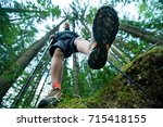 traveler in hiking boots with... | Shutterstock . vector #715418155