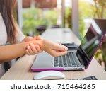 closeup woman holding her wrist ... | Shutterstock . vector #715464265